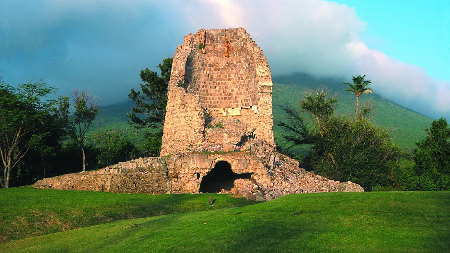 Large stone sugar mill ruins at second hole on golf course