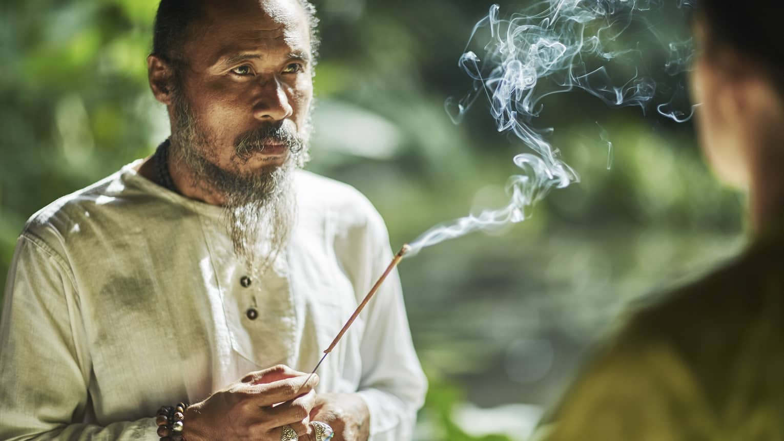 Balinese healer with burning incense