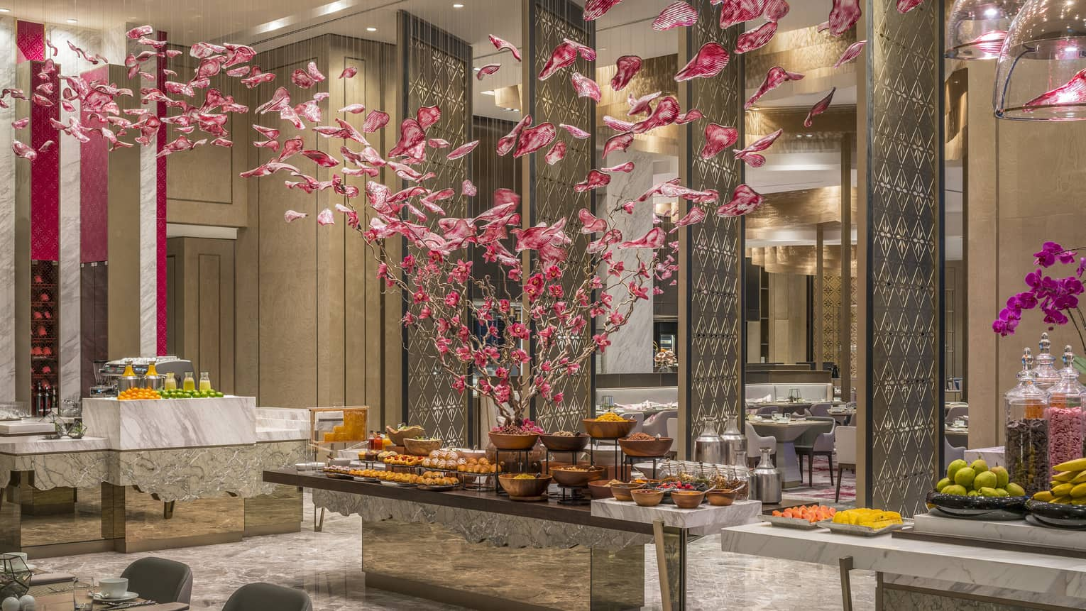 Curate buffet with floral arrangement