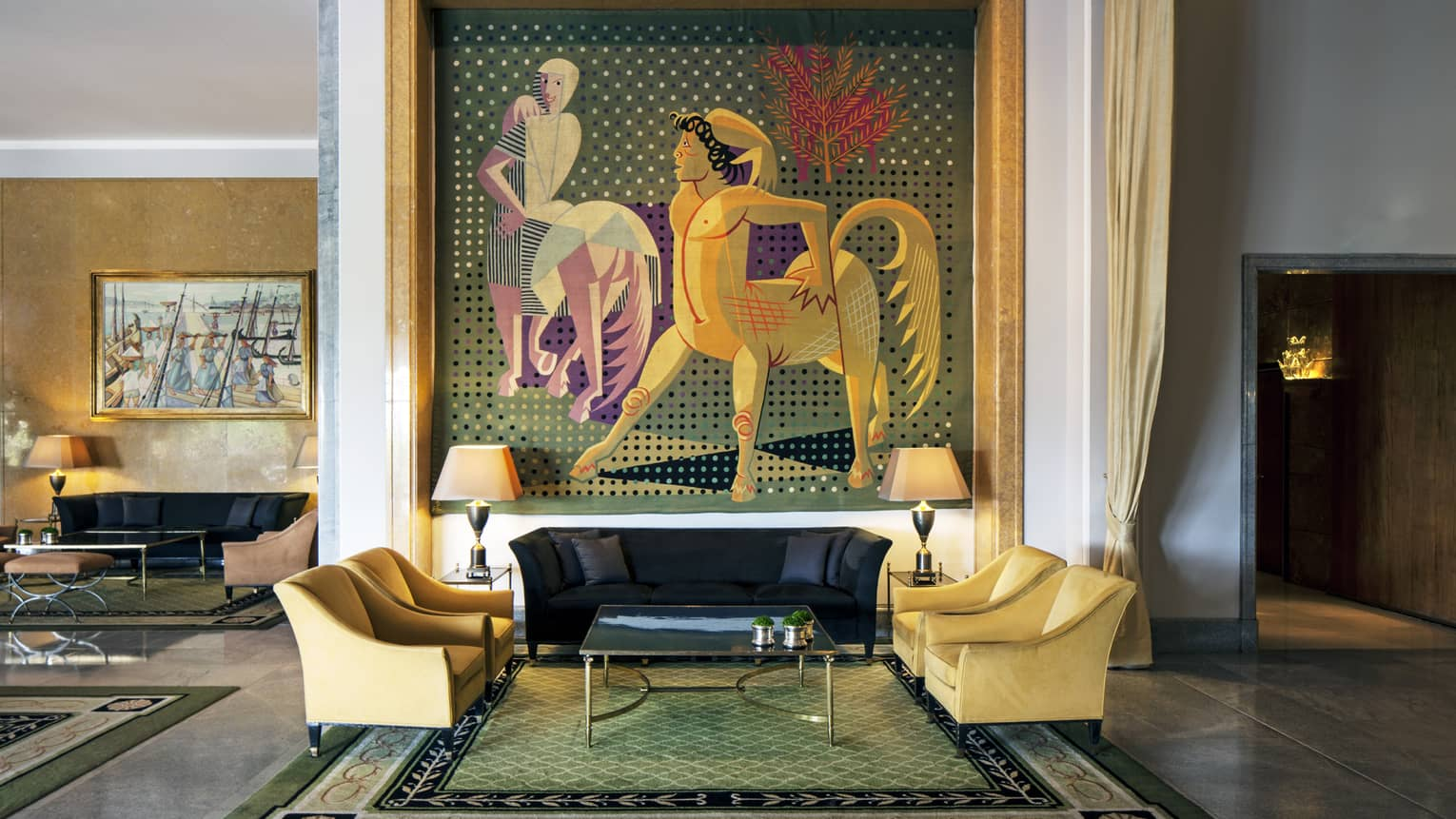 Almada Negreiros Lounge yellow armchairs below large handmade tapestry depicting centaurs