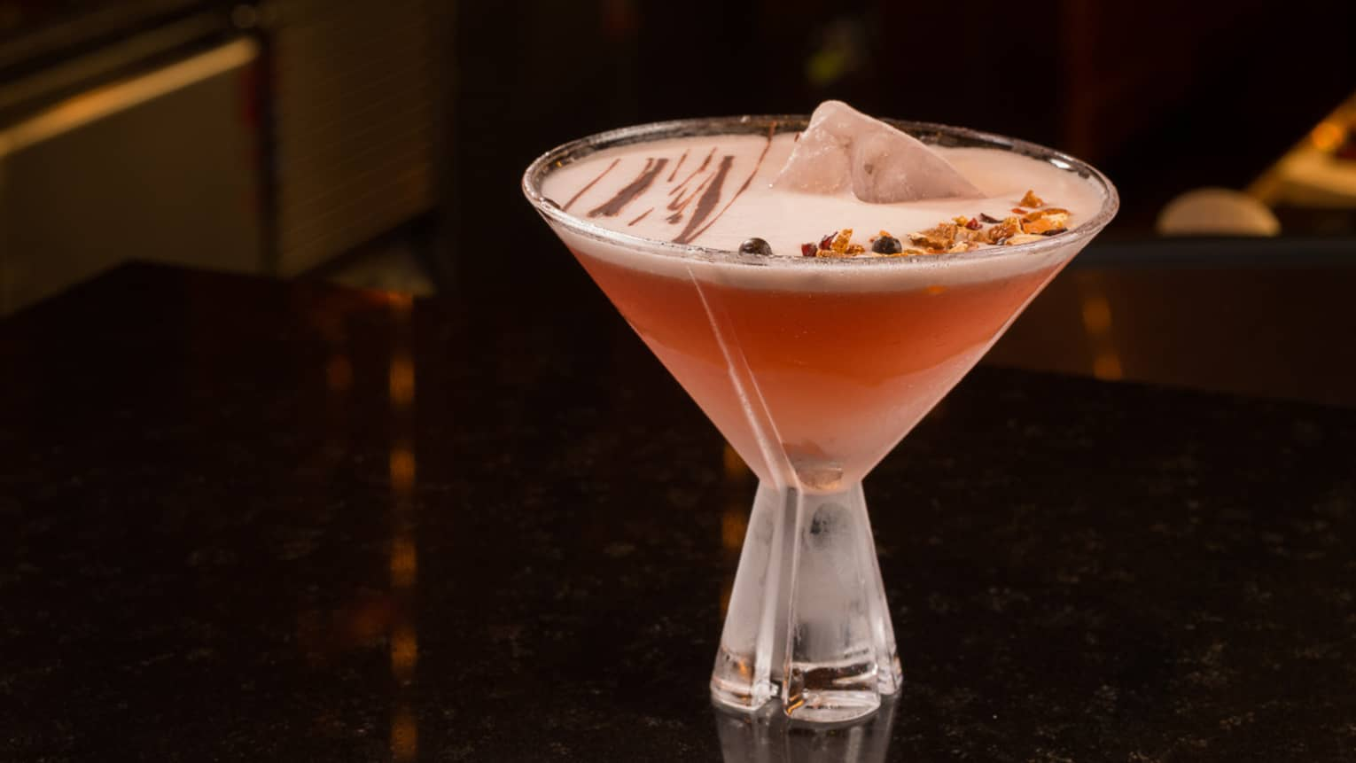 Carmenere Cocktail in martini glass, pink drink with creamy foam drizzled with chocolate
