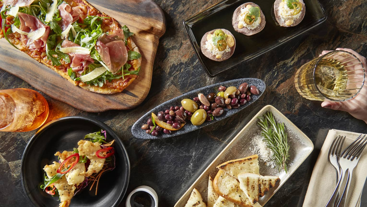 Food details from the Grain Bar, including pita bread, olives, flat breads and more