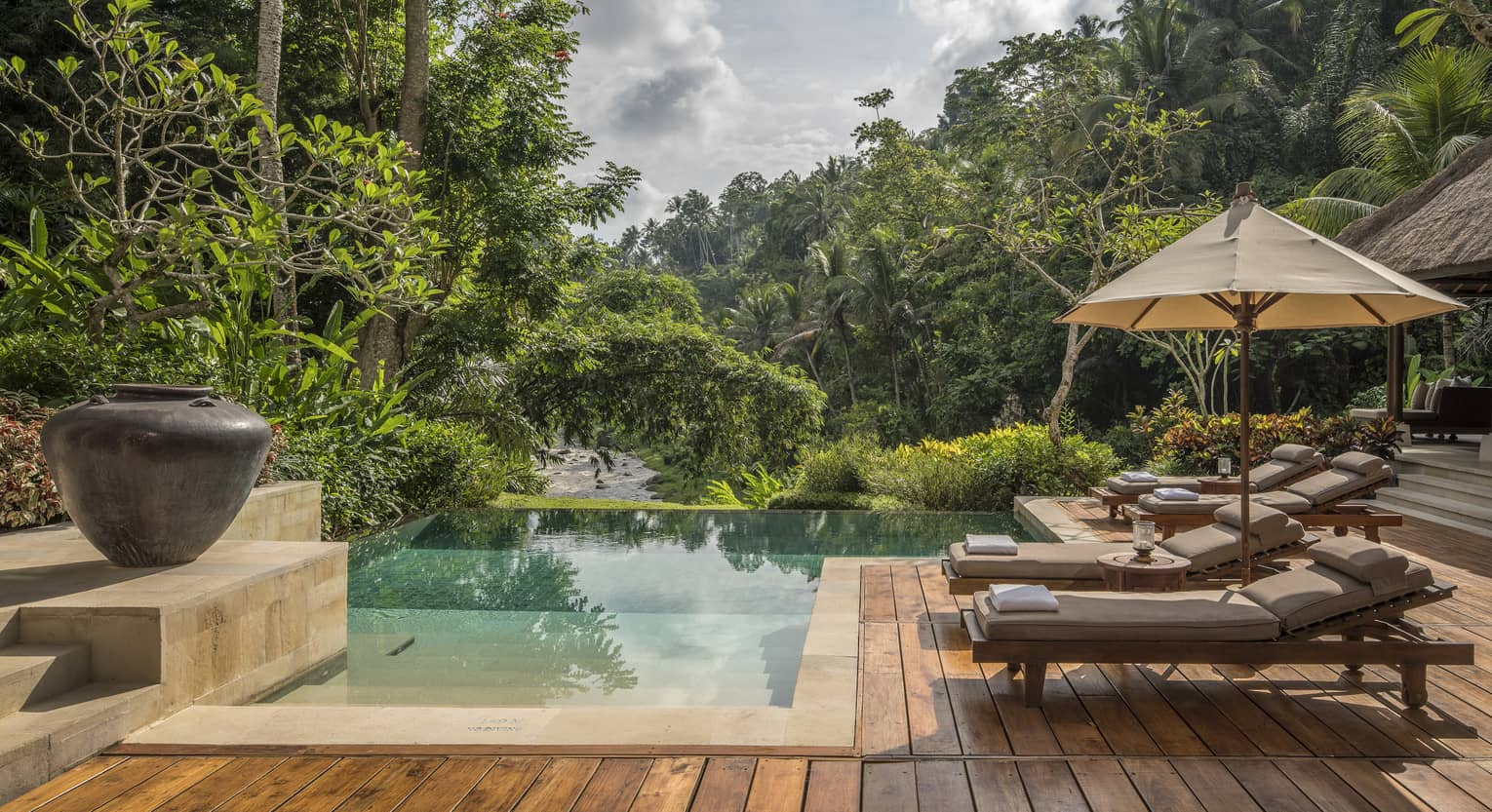 A relaxing villa with an infinity pool overlooking a river in Bali