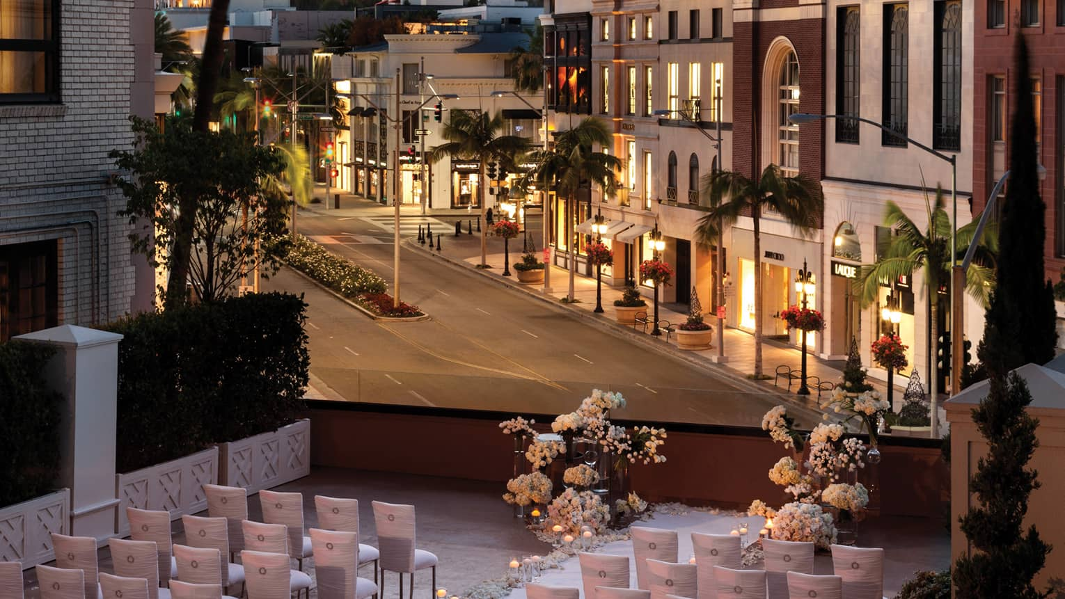Wedding set up on terrace above Beverly Hills street view at sunset