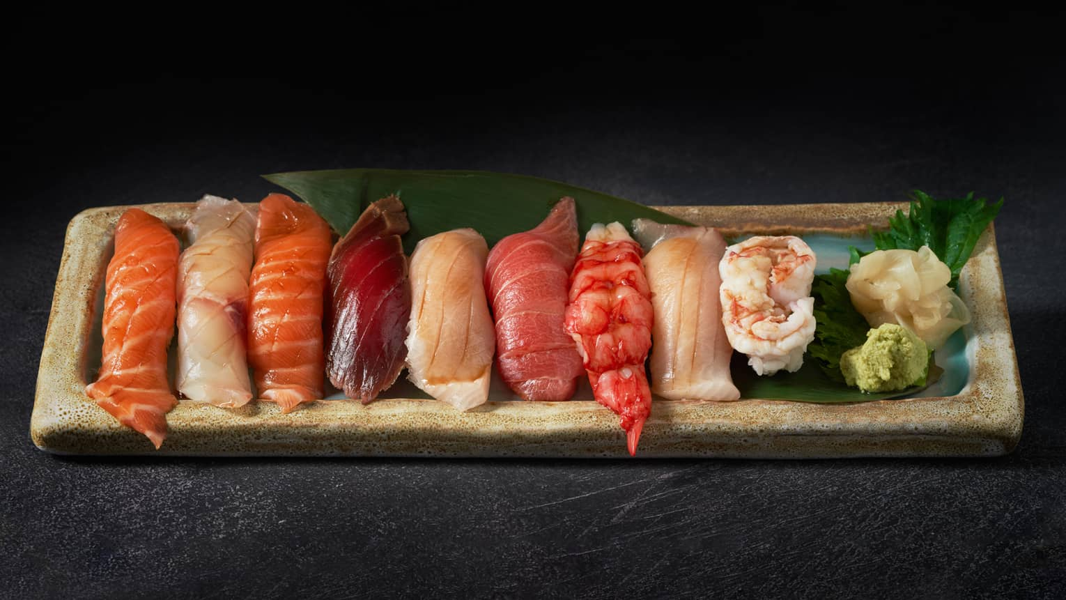 A variety of sushi, served with wasabi and ginger