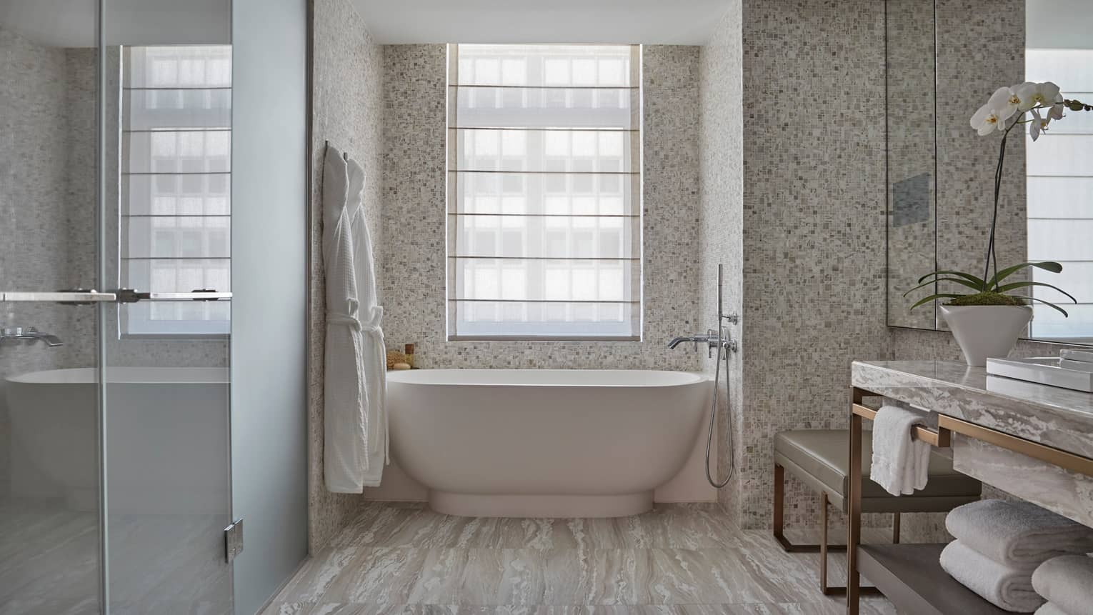 Corner Room bathroom with glass walk-in shower, white freestanding tub, vanity, white orchid