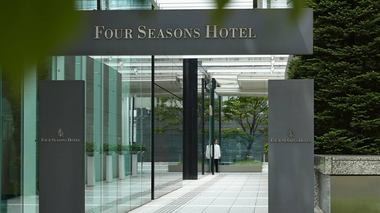 Four Seasons Hotel Tokyo at Marunouchi grey sign over glass entrance