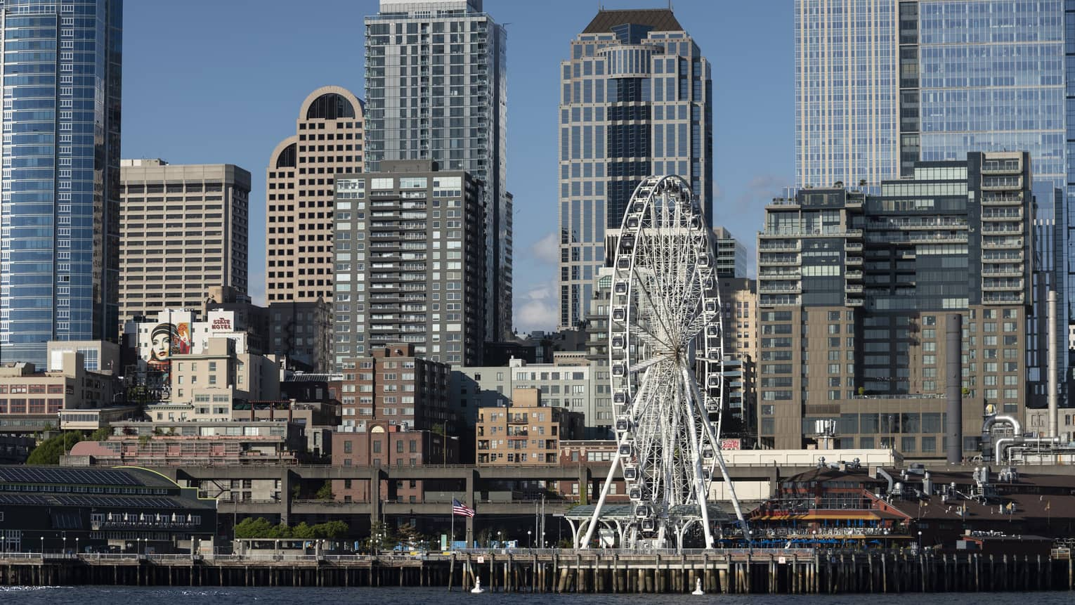 The Seattle Great Wheel stands out among skyscrapers on Elliott Bay