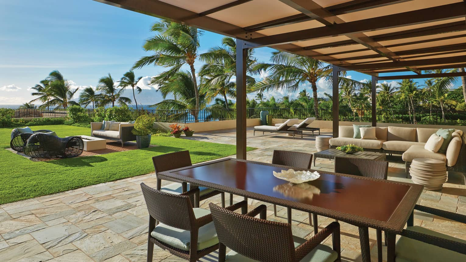Lokelani Suite Outdoor Area with dining table and view of the ocean