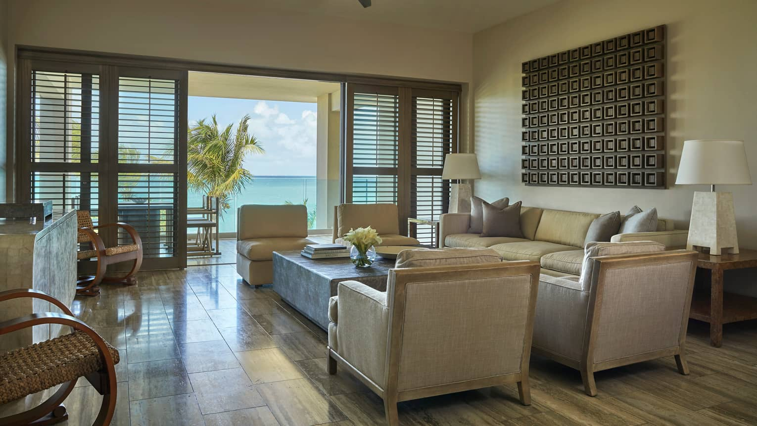 Three-Bedroom Ocean-View Residence back of armchair, seating area with sofa, coffee table, open patio shutters to sunny deck