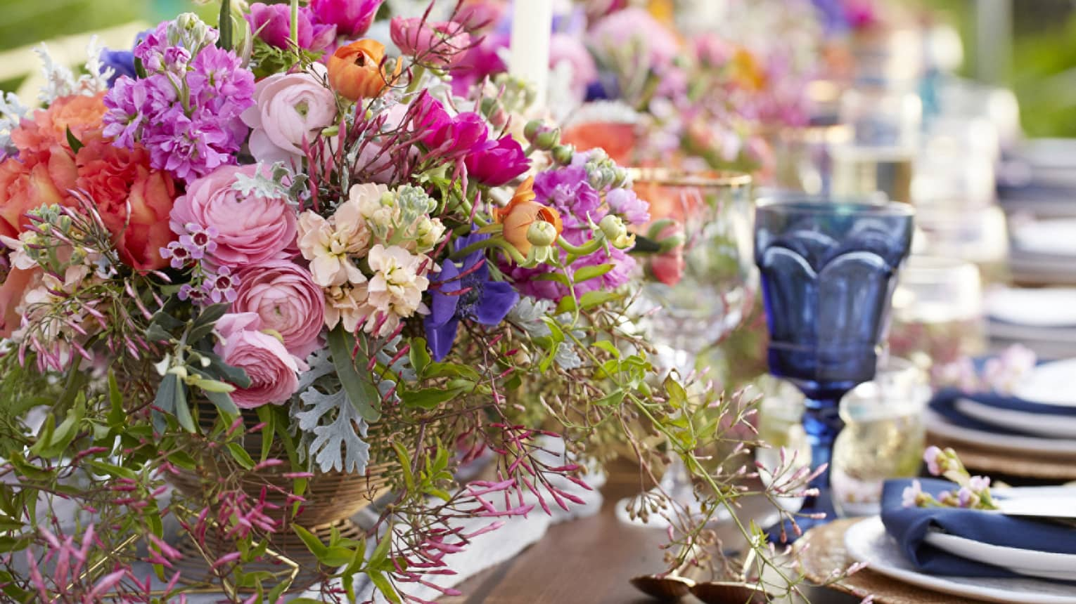 Floral wedding centerpieces decorate the table at a wedding in Maui, Hawaii