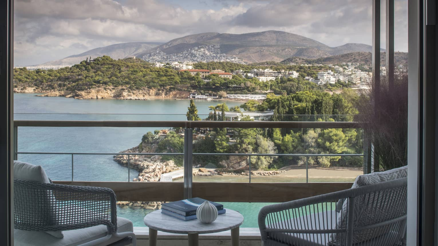 Four Seasons Astir Palace Hotel Athens balcony chairs, table with books, overlooking sea, trees, mountains