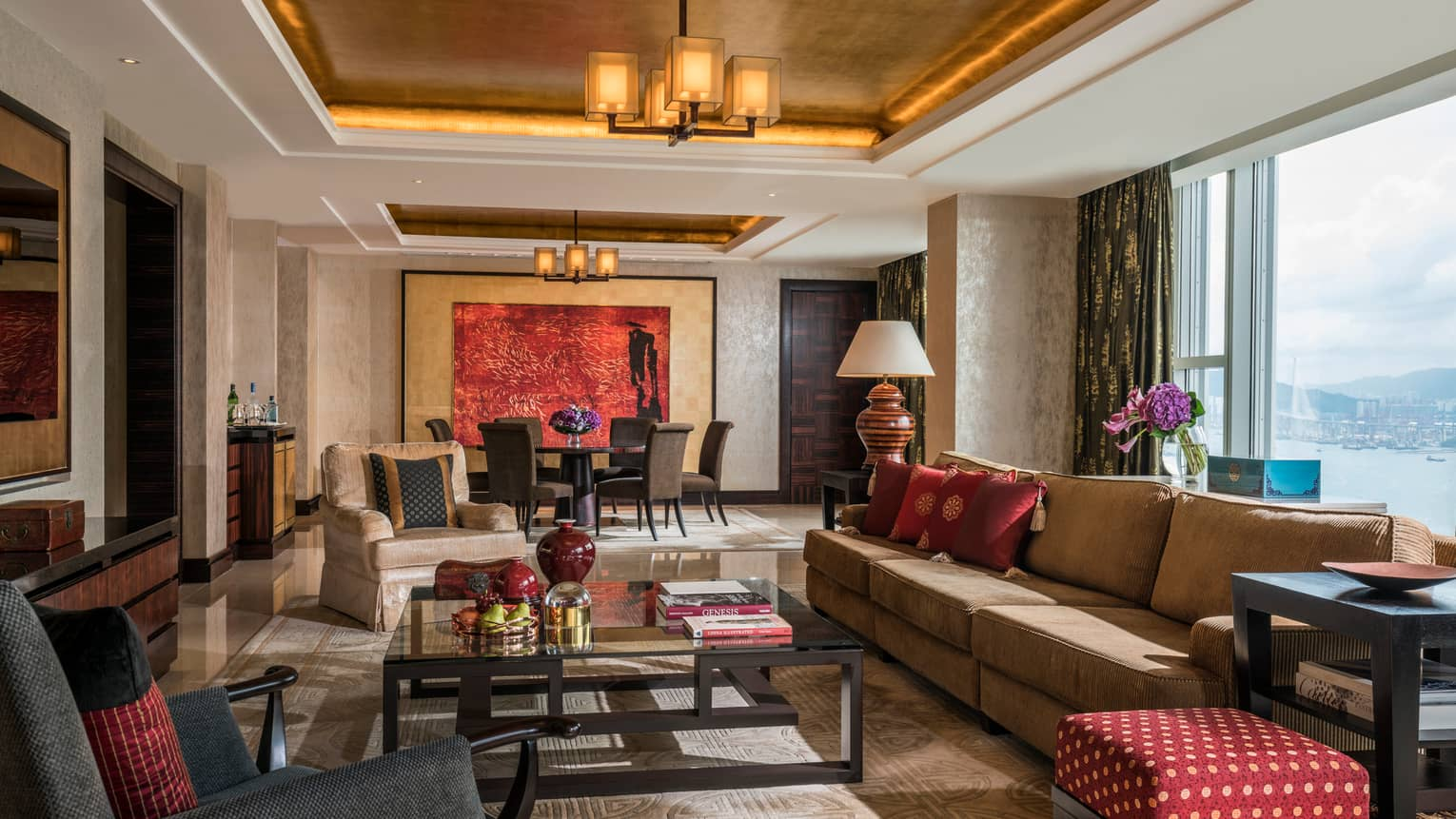 Imperial Suite large living room with plush sofas, armchairs, wall-length window with harbour view
