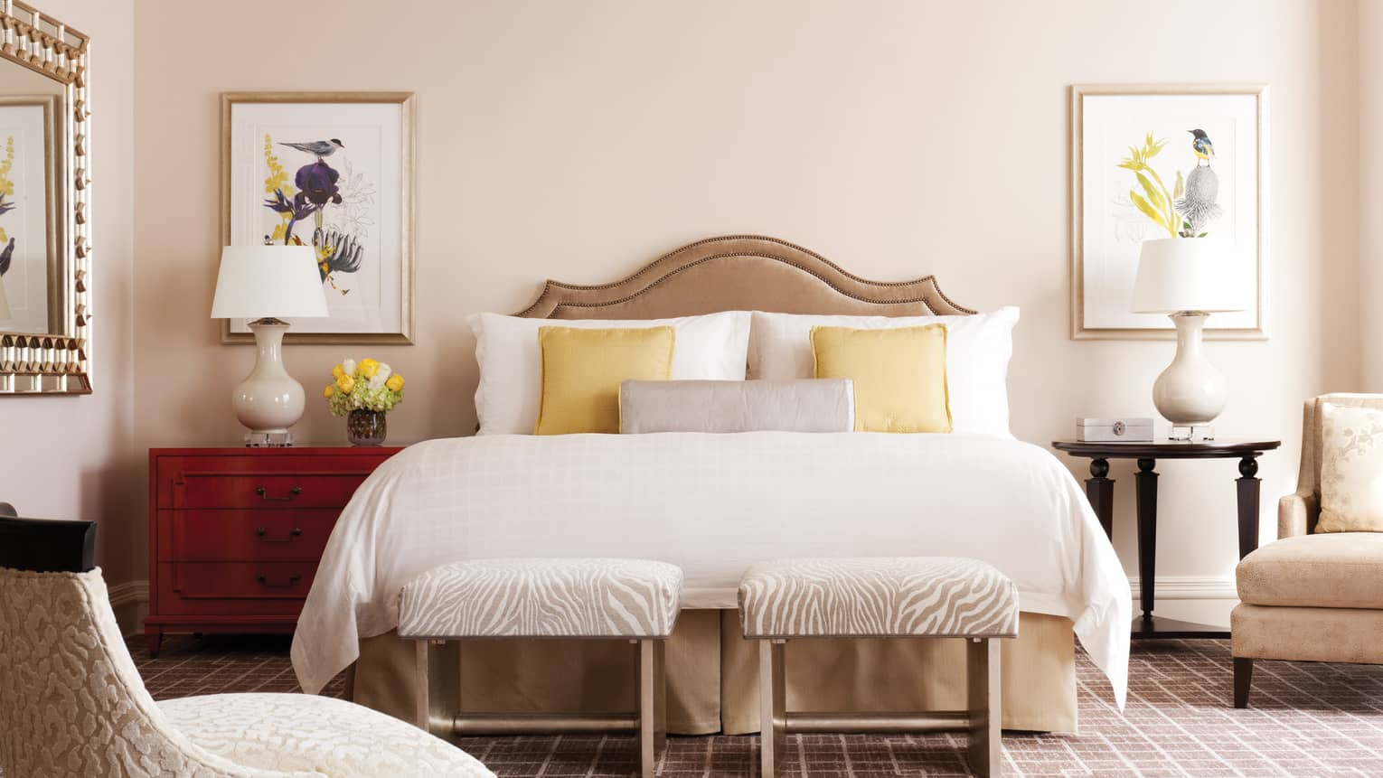 The bed in the Presidential Suite North, with a warm cream-and-yellow decor