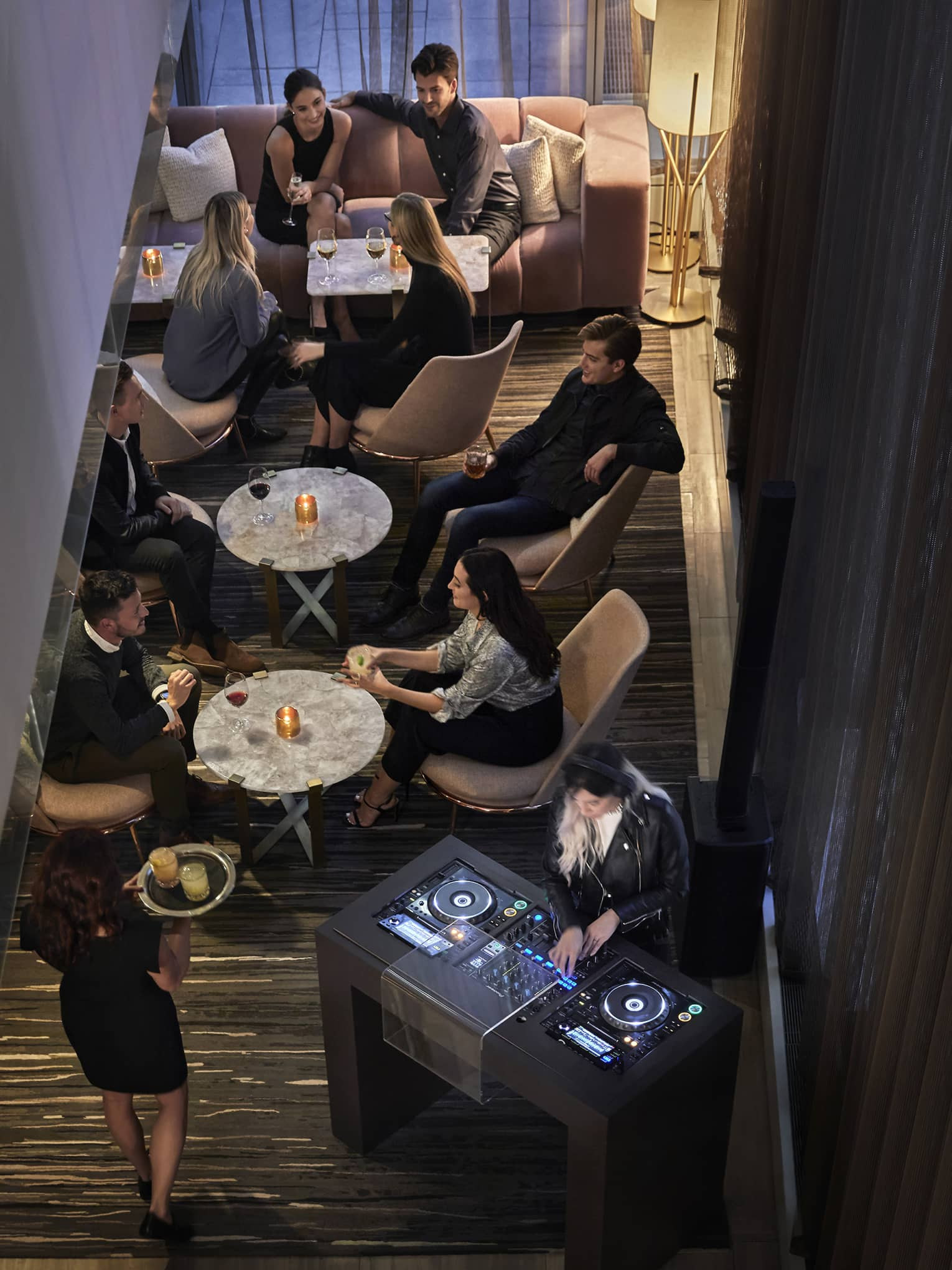 An aerial view of guest enjoying drinks and a DJ performing