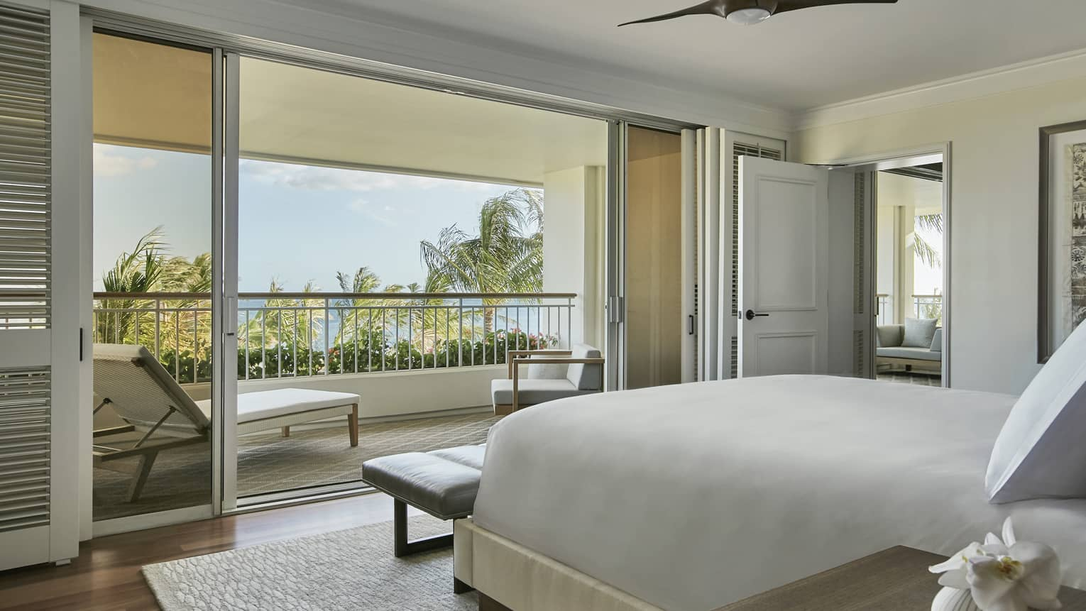 Penthouse Suite bedroom, end of bed, bench by sliding glass balcony doors