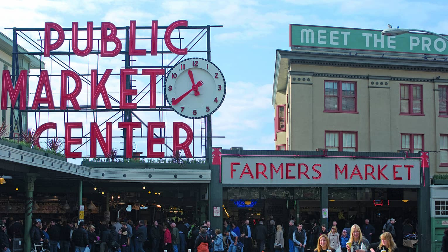 Public Market Center and Farmers Market signs over crowd along sidewalk