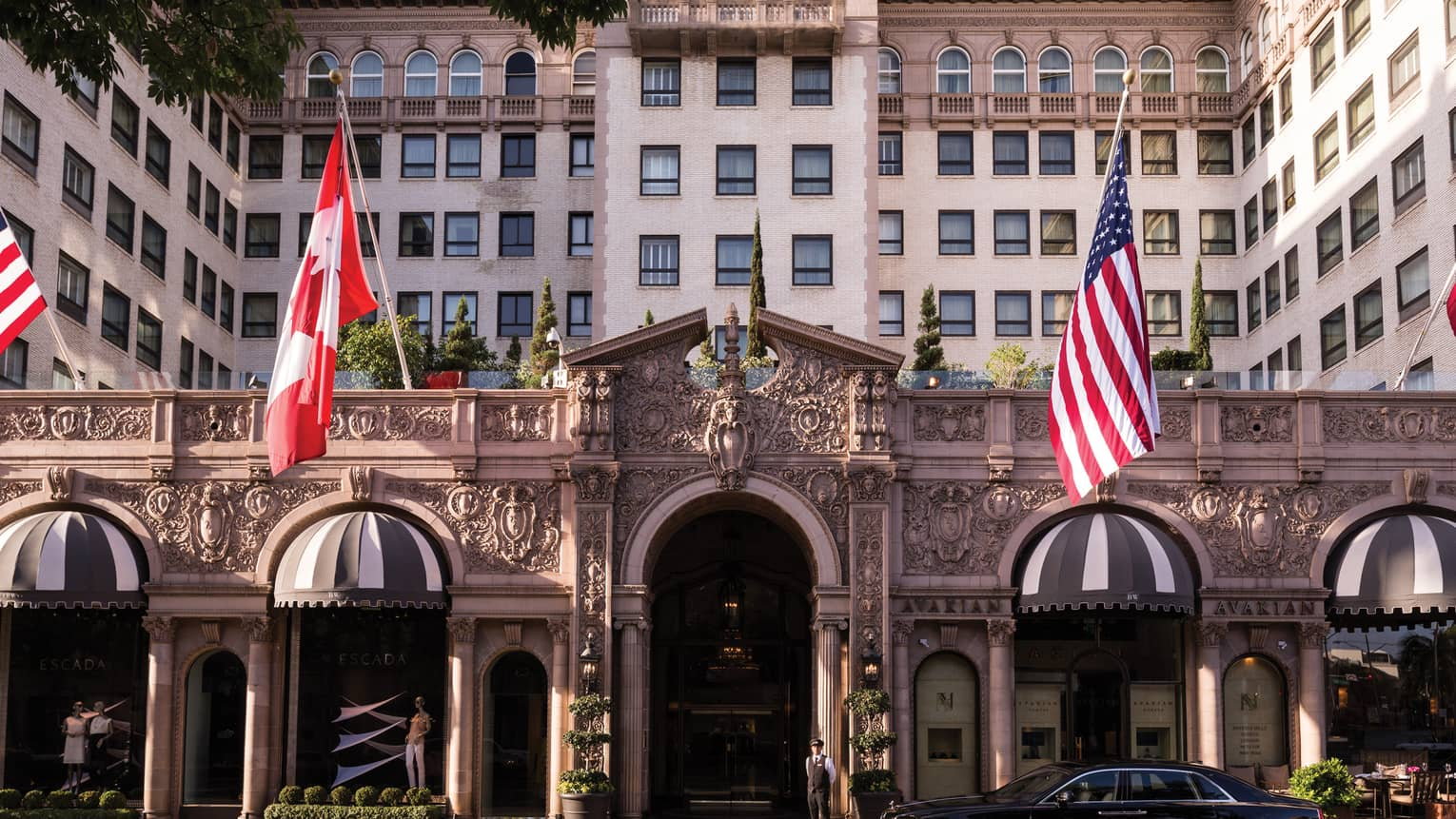 Four Seasons Hotel Beverly Wilshire grand front entrance with American, Canadian flags