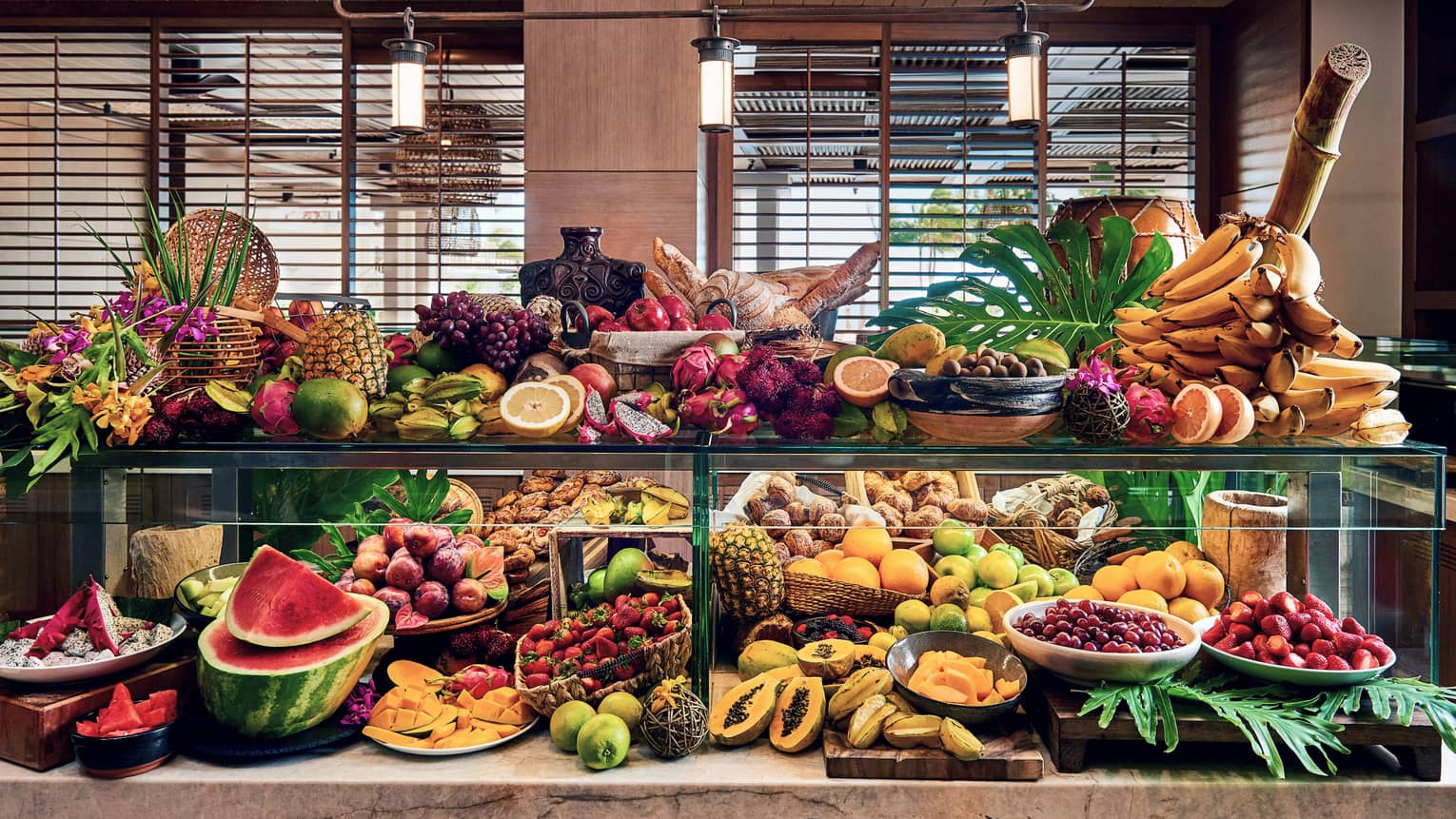 Large brunch fruit spread across buffet counter