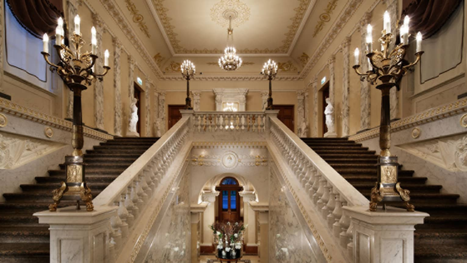 Historic Grand Staircase with lights in hotel lobby