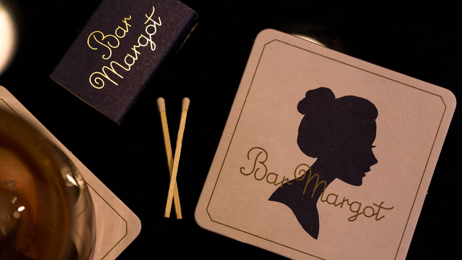 Bar Margot matchbox, two matches and coaster with vintage silhouette of woman's face