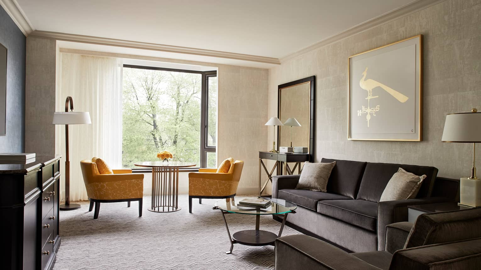 Garden View Executive Suite grey velvet sofa and armchair, golden yellow plush armchairs beside bright window