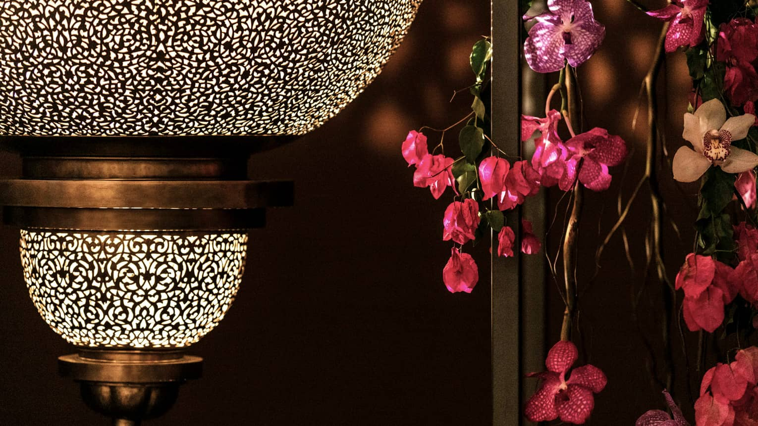 Close-up of Moroccan lantern, pink flowers in Atlantique Ballroom
