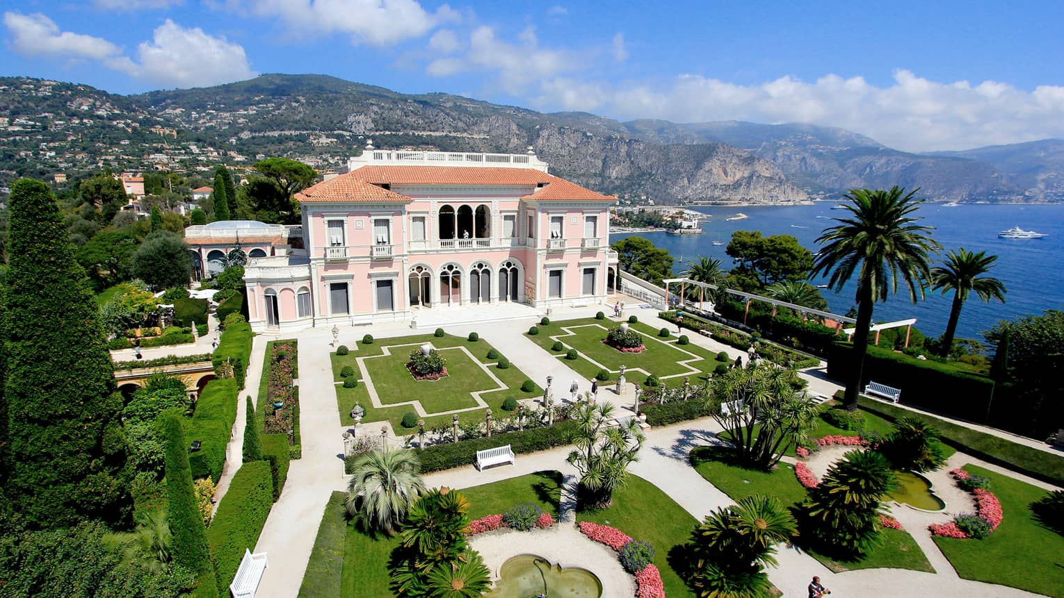 The Grand Hotel, overlooking the water with beautiful arches and pristine gardens