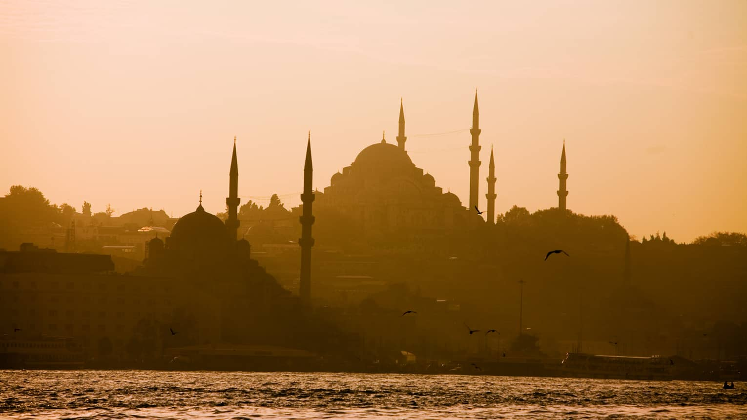 Silhouette of domed Blue Mosque in Istanbul at sunset