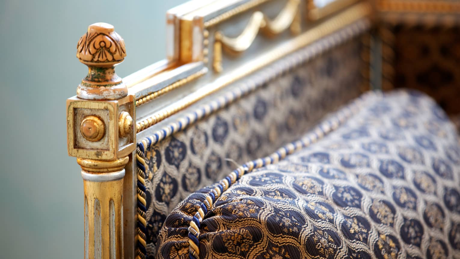 Close-up of neoclassical, traditional-style furniture with gold details