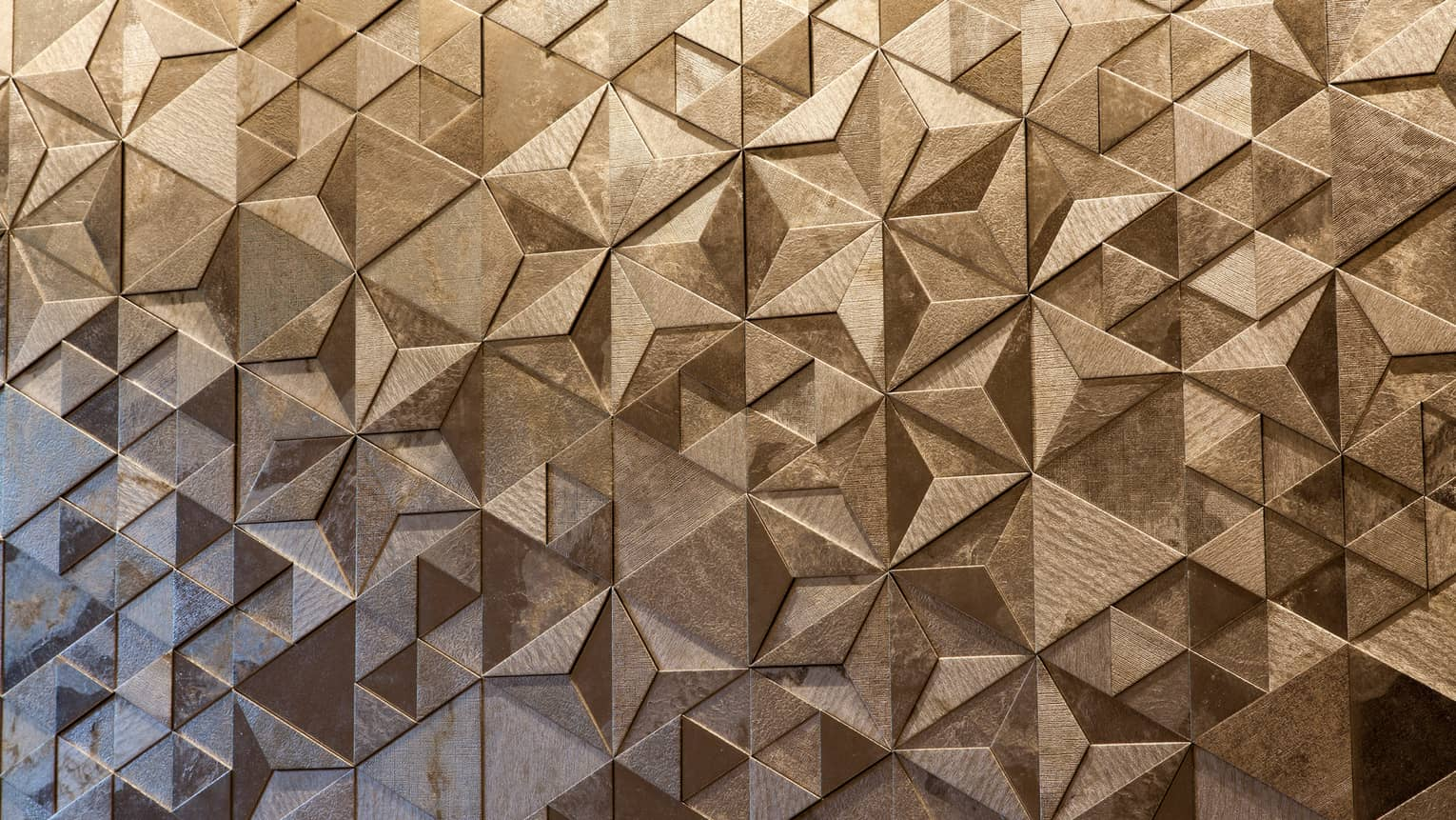 Close-up of Sushi Wakon geometric designs on silver tile wall
