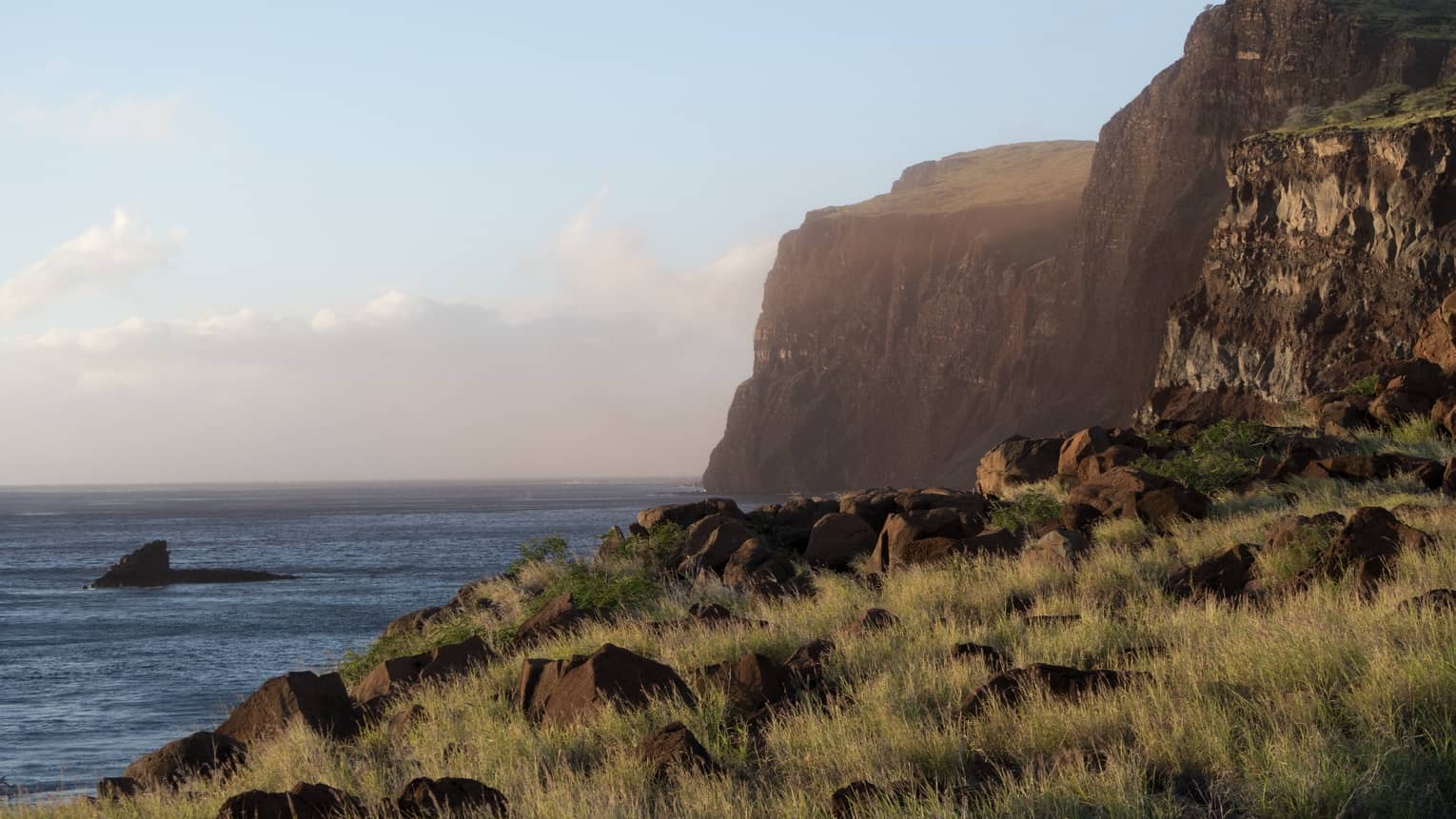 Cliffs, grass over ocean along rugged Lanai, Hawaii coastline