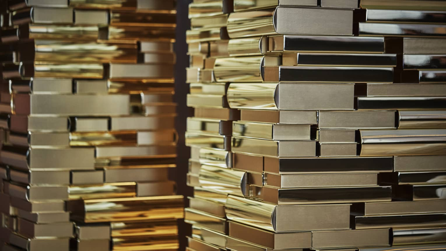 Art installation resembling many golden stacked books