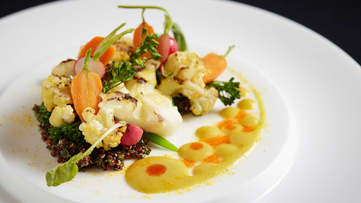 The Garden cauliflower steak with black walnut quinoa and fragrant pear curry emulsion, on plate