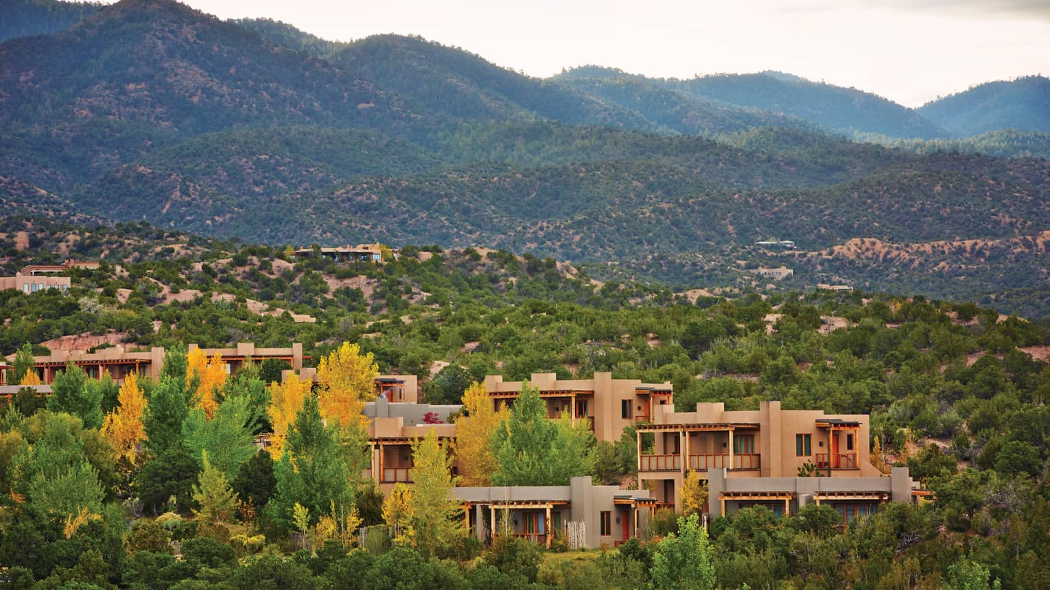 Aerial view of Four Seasons Resort Santa Fe in desert mountains