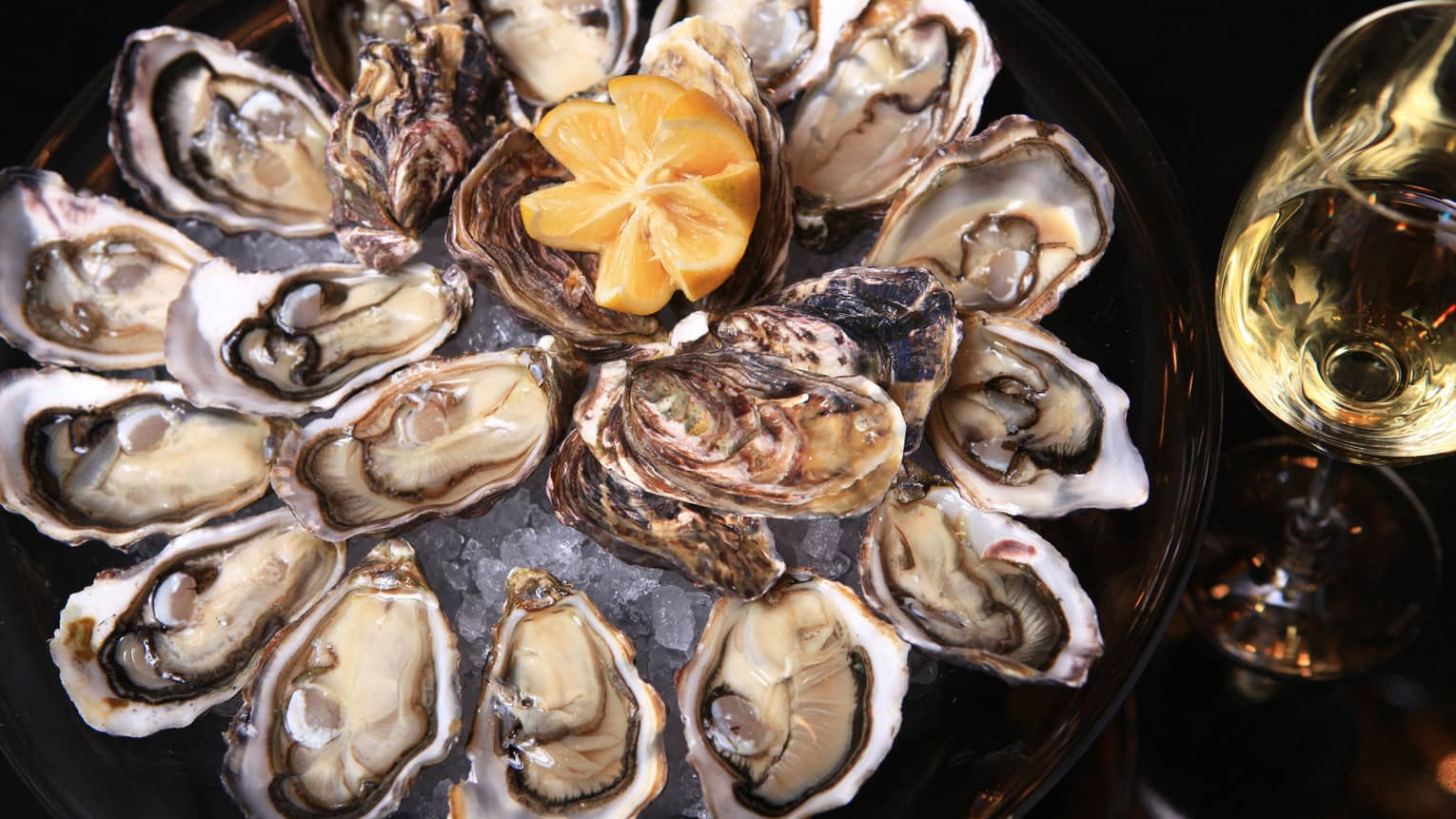 Fresh oysters in half shell arranged on platter