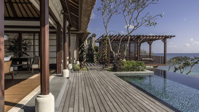 Royal villa wood patio boards, wood pillars, infinity pool looking out at ocean