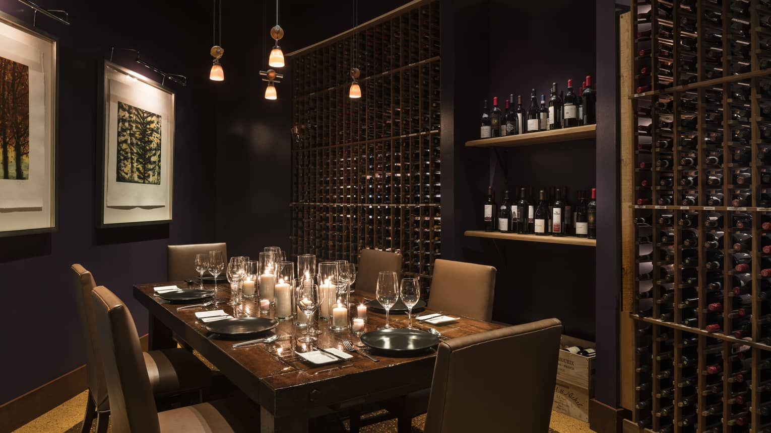 Private candlelit dining table in wine cellar