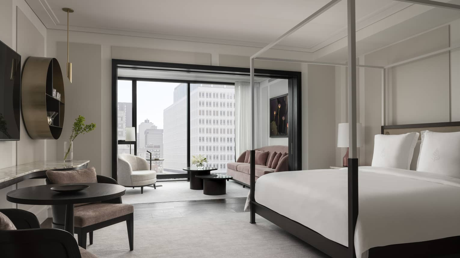 Chic, modern guest room with neutral decor and black trim, floor-to-ceiling window