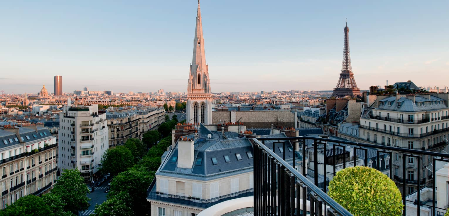 View over Paris rooftops, cathedral towers, Eiffel Tower