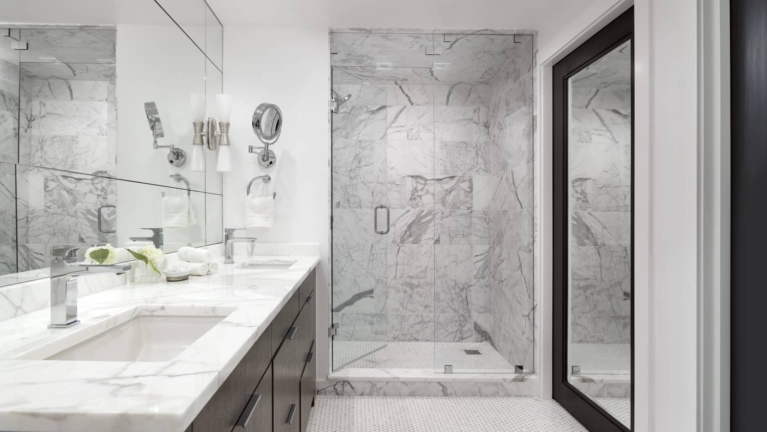 Large bathroom with walk-in white-and-grey marble shower, marble vanity