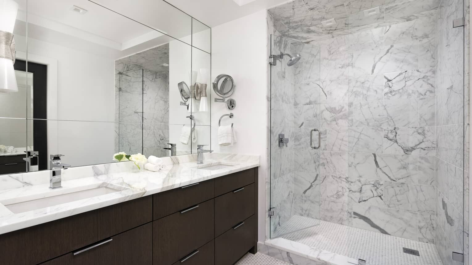 Bathroom with walk-in marble shower, long marble vanity