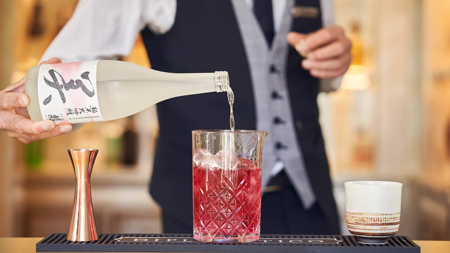 A handcrafted Asian cocktail is delicately prepared