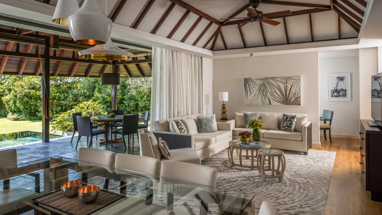 Garden Residence Villa large dining table, modern lights from cathedral ceilings, living room