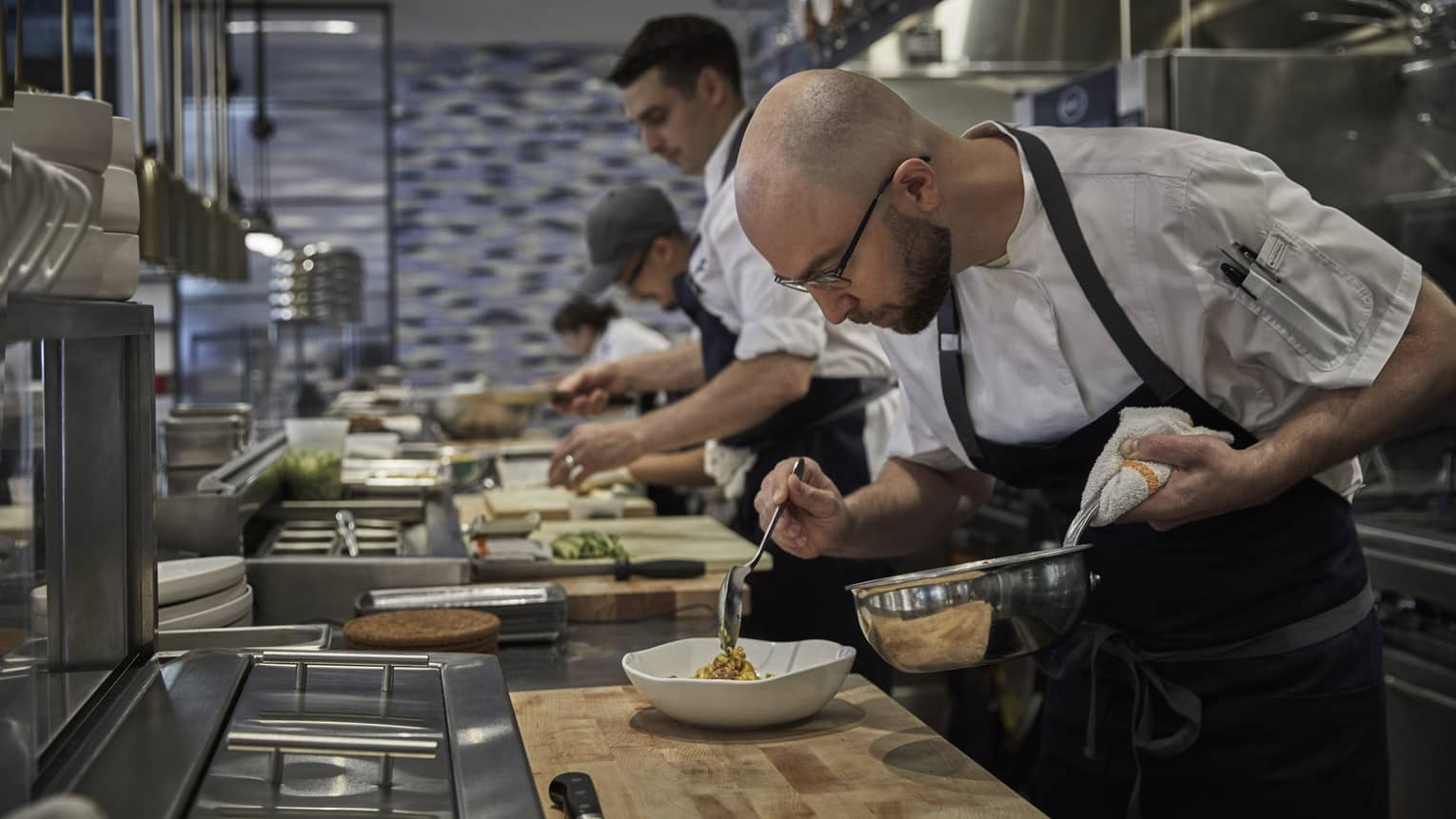 Four Seasons chefs prepare a delicious meal in the kitchen of Four Seasons Philadelphia