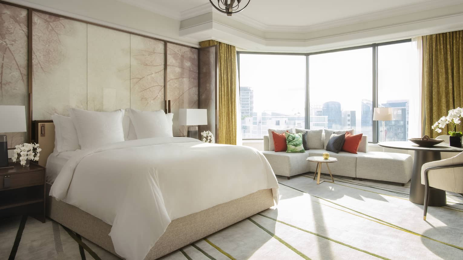 Royal Suite bedroom with floor-to-ceiling windows with a view of the city