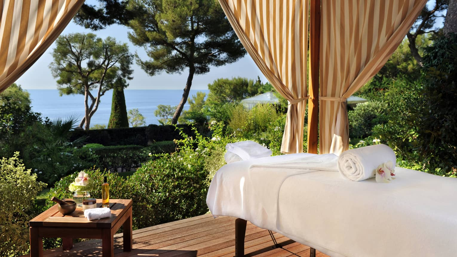 Massage bed on outdoor Spa pavilion overlooking gardens, sea