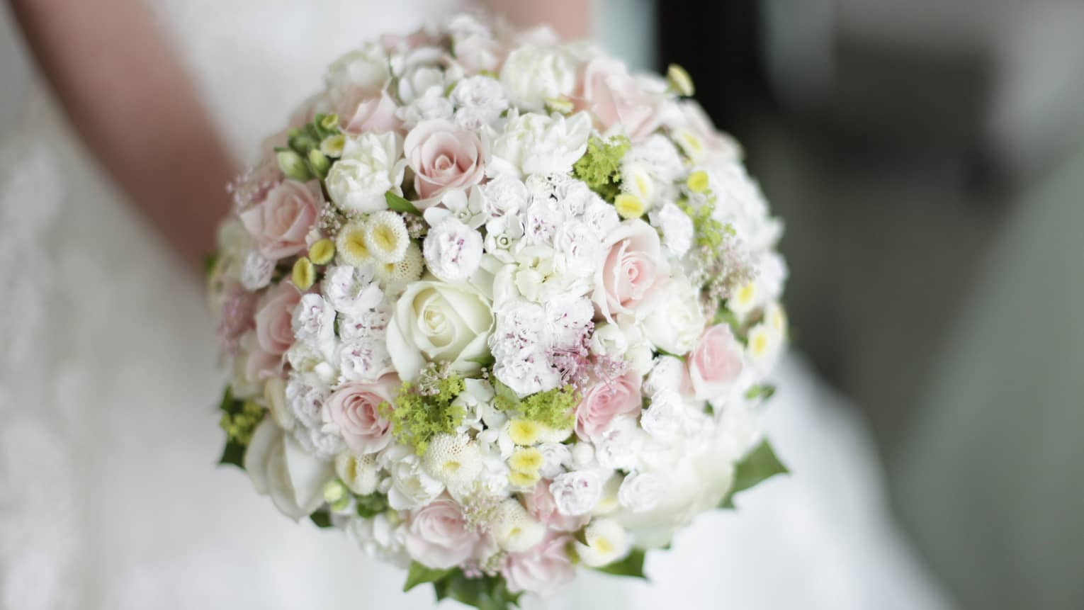 Round floral wedding bouquet with small white and pink roses
