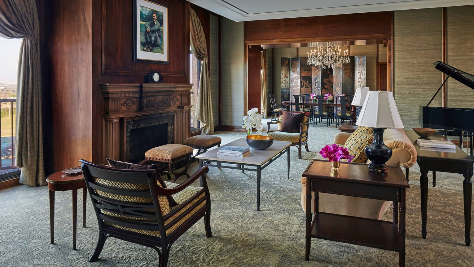 Byron Nelson Suite dark wood walls, fireplace, seating area under soaring ceilings