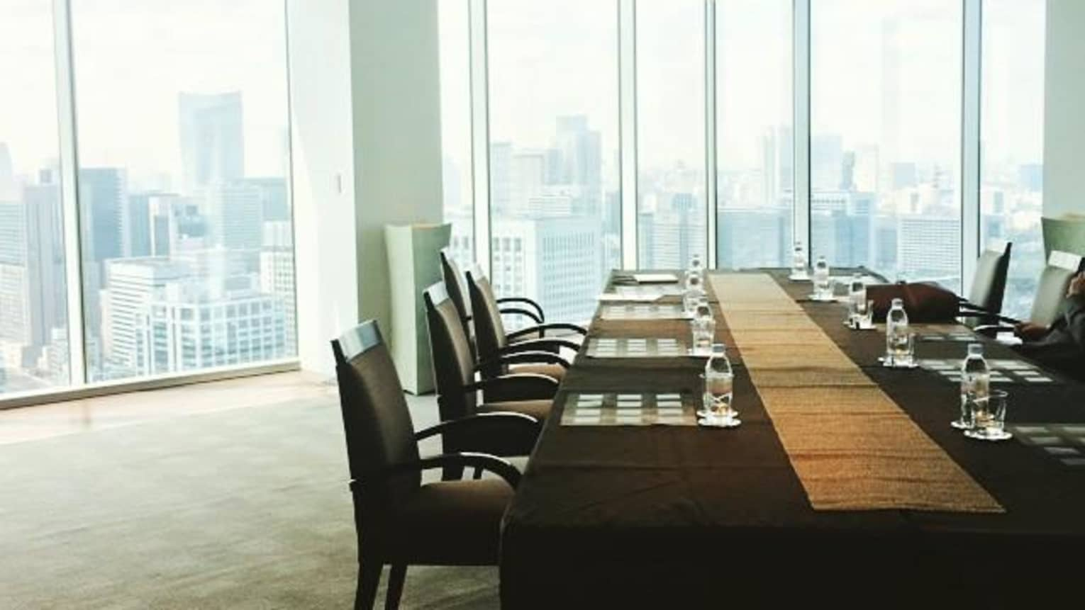 Long meeting table by sunny window